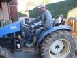 Francesco alla guida di un trattore dell'azienda
