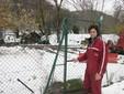 Matteo apre il cancello che porta alle due stalle di Borgo San Dalmazzo