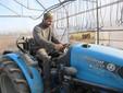 Luca sul trattore aziendale