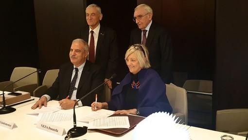 Genta, Vigna, Quaglia e Guzzetti alla firma dell'atto di fusione
